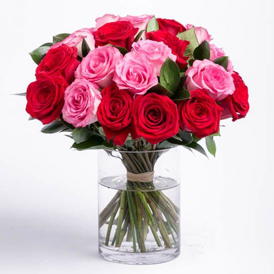 Combination of Red and Pink Roses Ruscus and Cylinder Vase from JuneFlowers.com