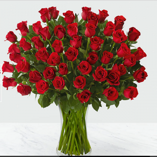 Lovely red roses in a vase from JuneFlowers.com