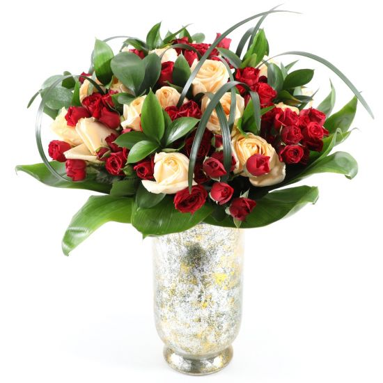 Gorgeou roses in a golden vase from JuneFlowers.com