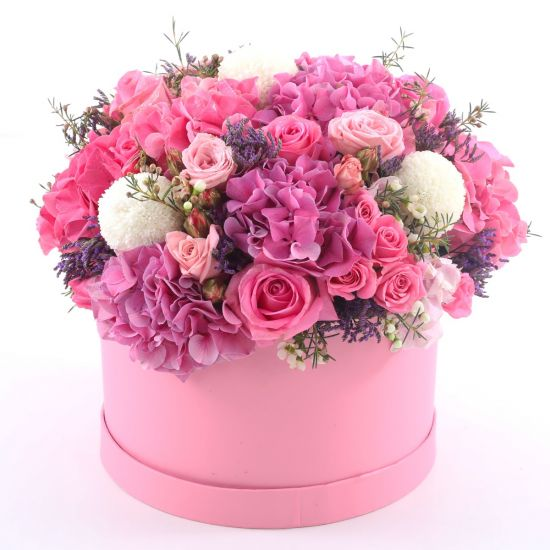 Combination of Ping Roses, Hydrangea,White Ping Pong, Light Pink Spray Rose, Dry Lavender in a pink round box from JuneFlowers.com