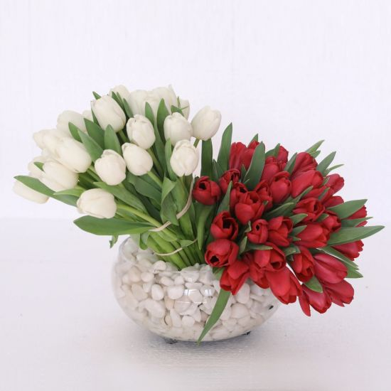 Beautiful white and red tulips in a glass vase from Juneflowers.com