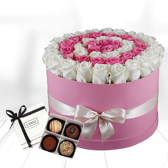 white and pink roses in round box