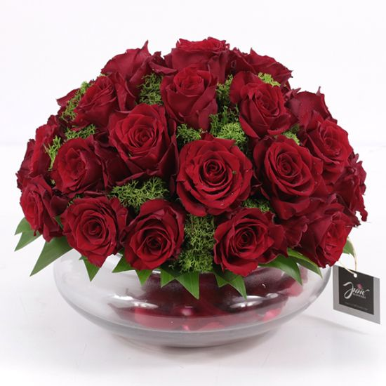 Romance of red roses in a round glass vase from JuneFlowers.com