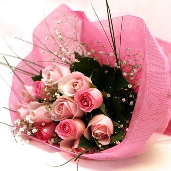 stunning bouquet of assorted 12  Pink Roses from JuneFlowers.com