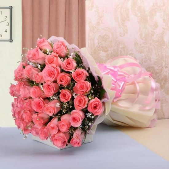 Surprise this 30 pink roses bouquet in a white wrapping sheet to your loved one from JuneFlowers