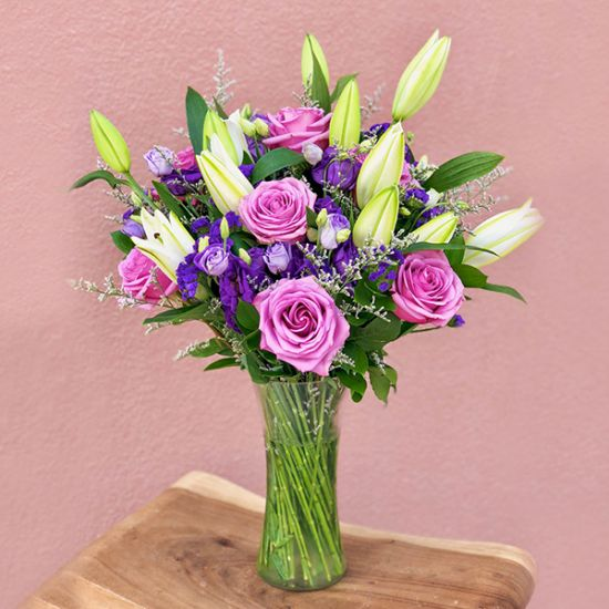 Lavish Pink Roes with Lilly in vase 