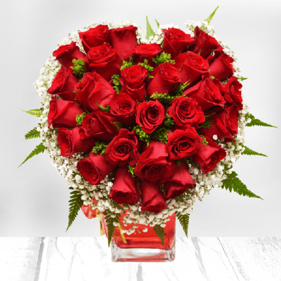 Beautiful Red roses in a heart shape in a vase from JuneFlowers.com