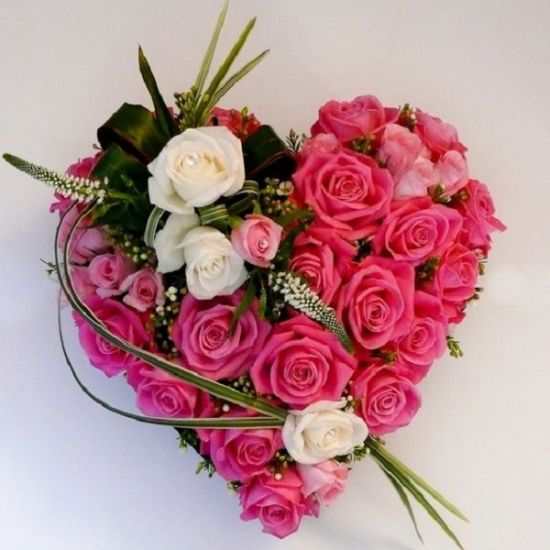 Passion pink roses in a heart shape from JuneFlowers.com
