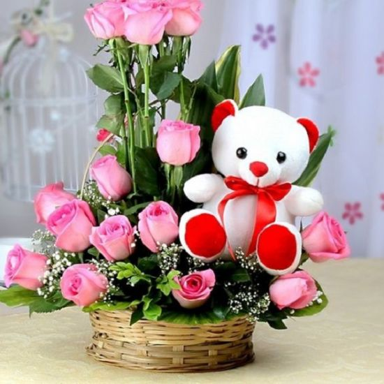 Fantastic Pink rose with teddy in a flower basket from JuneFlowers.com