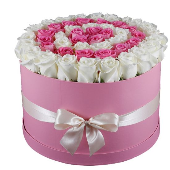 Colourful pink roses and white rose in a round shape in a pink box from juneflowers.com