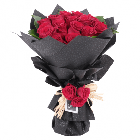 Romantic Red roses in  a black wrapping sheet from JuneFlowers.com