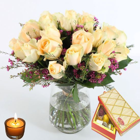 roses in a glass vase with sweet box
