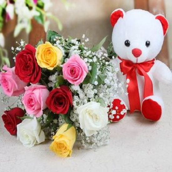 colourful roses with babys breath and one white teddy from JuneFlowers.com