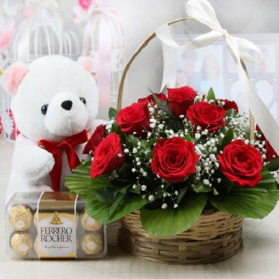 Red Roses in a basket with one teddy and Ferraro rocher chocolate box