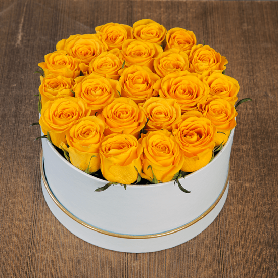 Yellow roses in a white rose box