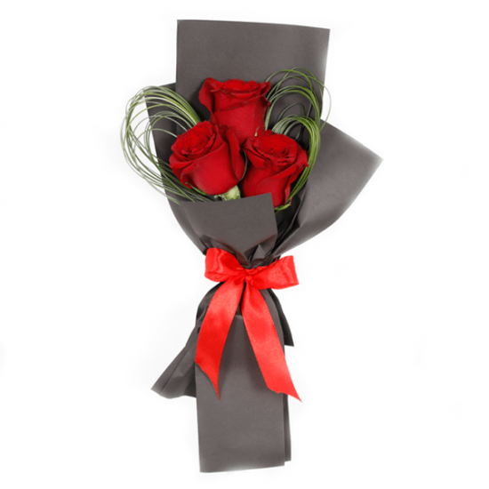 Fantastic Red roses in a black wrapping sheet from JuneFlowers.com
