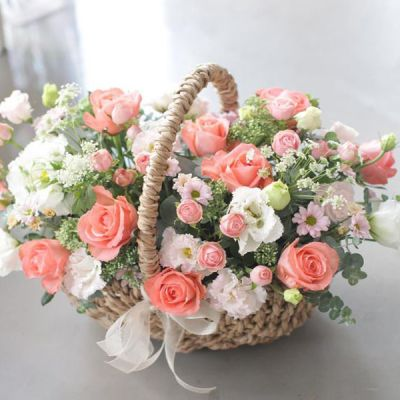 Mixed Colour Roses in a Basket from JuneFlowers