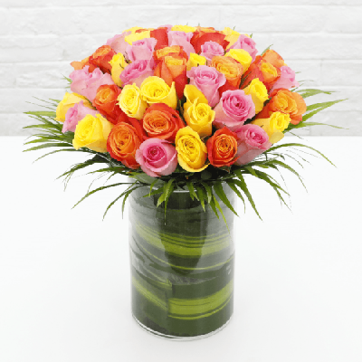 Colourful Roses in a cylindrical vase from JuneFlowers.com