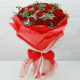 Red Roses filling with seasonal greenery by red wrapping from JuneFlowers.com